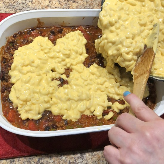 Top chili with mac and cheese
