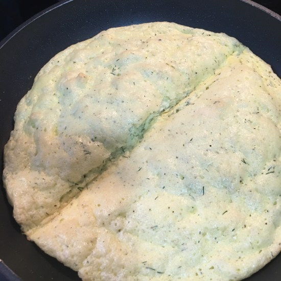 Making folding crease in Puffy Herb Omelet with Chevre