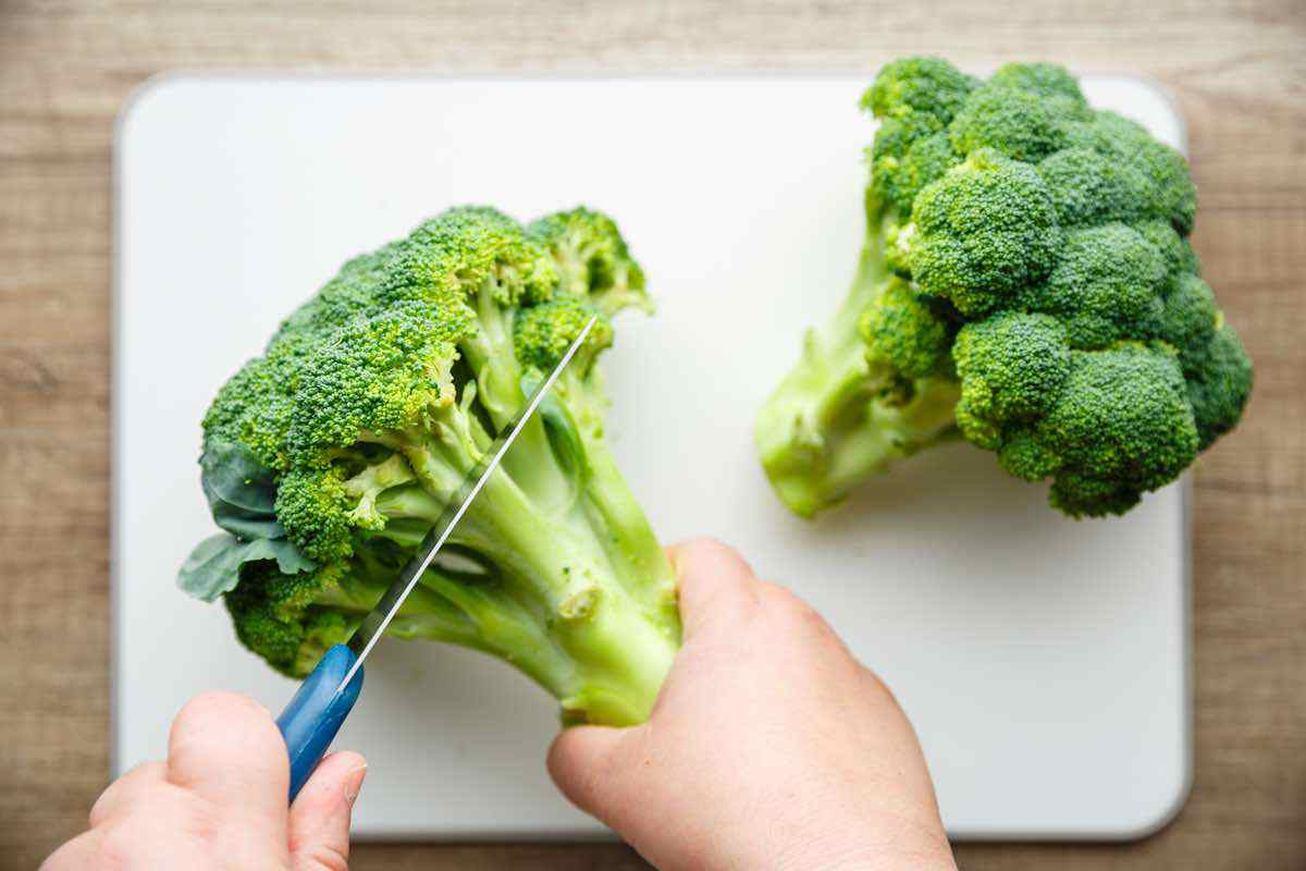 chopping raw broccoli