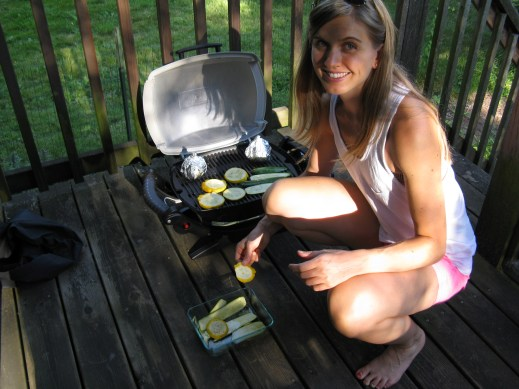 Putting veggies on the grill.