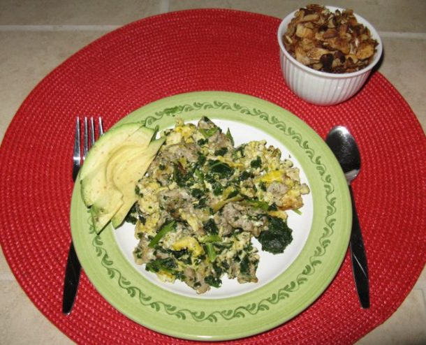Scramble with pastured eggs and homemade breakfast sausage, avocado, and a small dish of homemade yogurt with fresh granola.