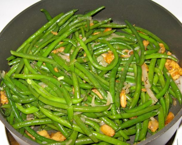 Green beans with sauteed chanterelles and shallots.