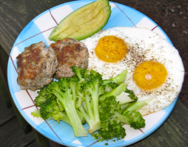 Homemade turkey patties with pastured eggs, broccoli and avocado.