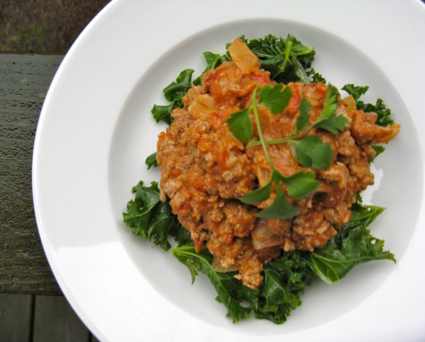 Indian-style turkey stew, served over steamed kale.