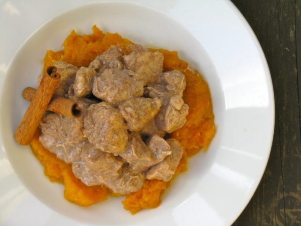 Creamy cinnamon chicken over mashed butternut squash.