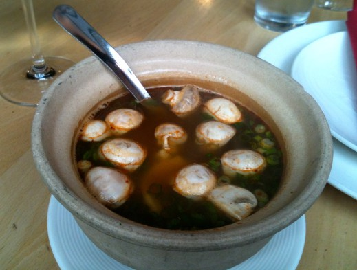 Tom yum soup -- loaded with mushrooms and big pieces of chicken.