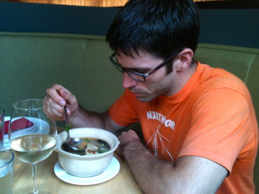 Jesse, eating his soup. He got a different kind of soup and had to be careful, as there were a lot of inedible things in it (lemongrass stalks, dried hot peppers, bones from pork ribs, etc.). (Taken on iPhone).