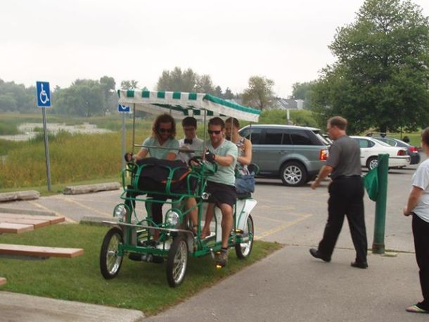 """Our surprise bike chariot that took us to the reception. My brother in-law and friend wore matching outfits and rode us all the way there. There was a """"newly married"""" sign and cans hanging off the back."""