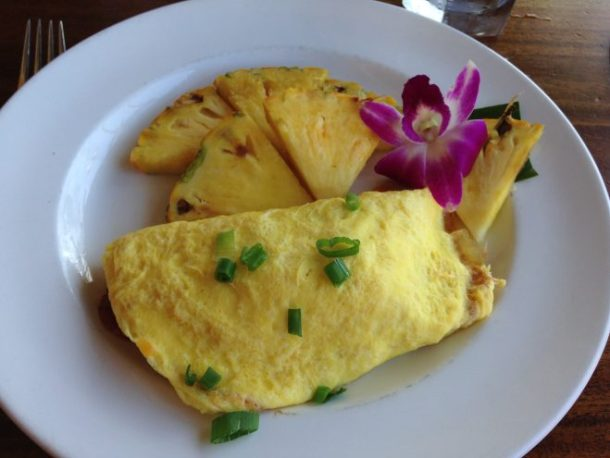 My breakfast to go with the view above: fresh pineapple and an omelet stuffed with meat! It was delicious.
