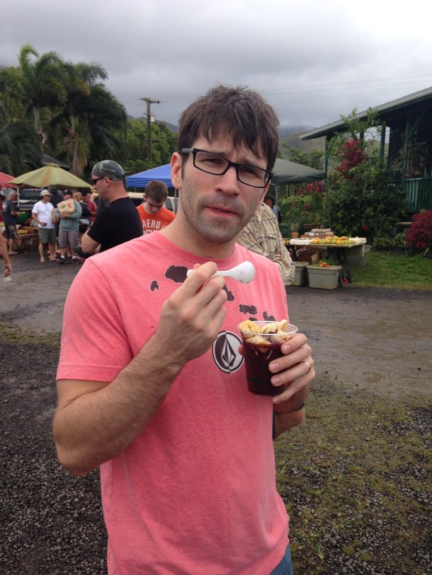 Jesse eating a homemade acai bowl (minus the granola) at the Hanelai farmer's market.