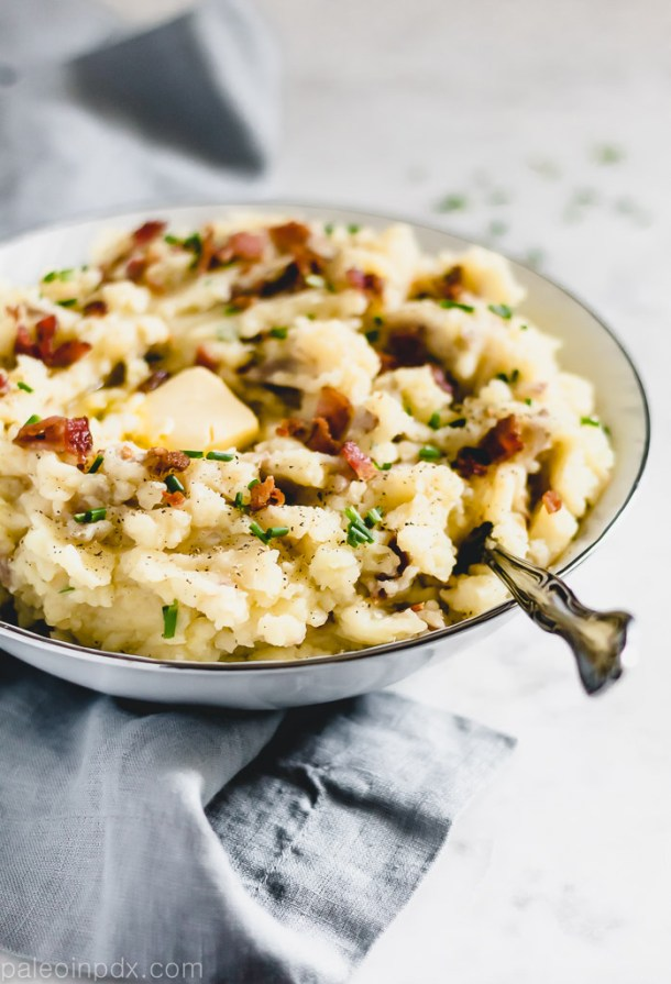 Mashed sweet and red skin potatoes with bacon