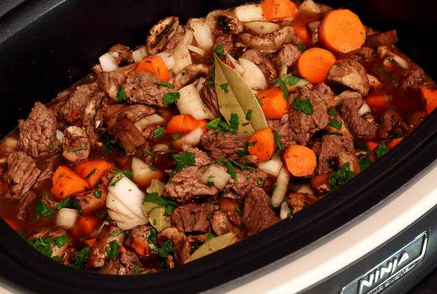 Paleo Newbie slow cooker with beef stew ingredients inside.