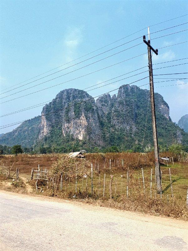 road limestone cliffs vang vieng