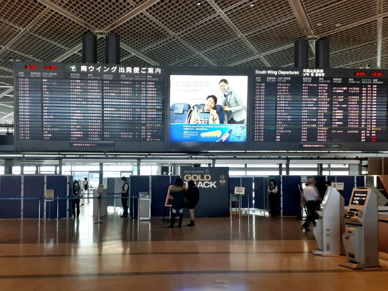 narita airport departures board gold track priority security