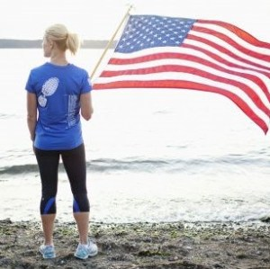 woman runner holding US flag