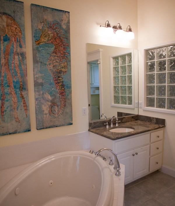 Nautical bathroom with seahorse artwork