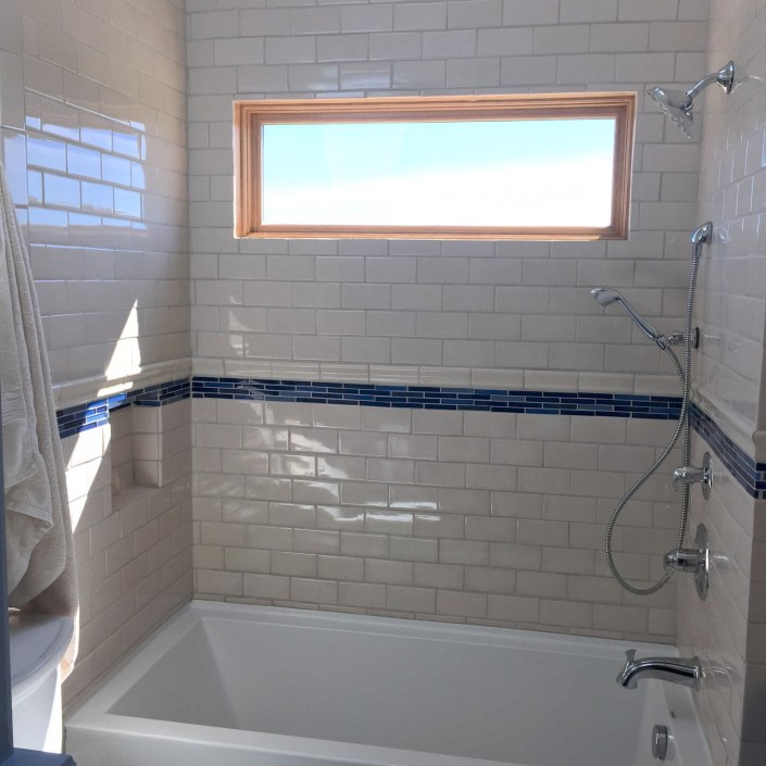 Kids modern white and blue subway tile for shower