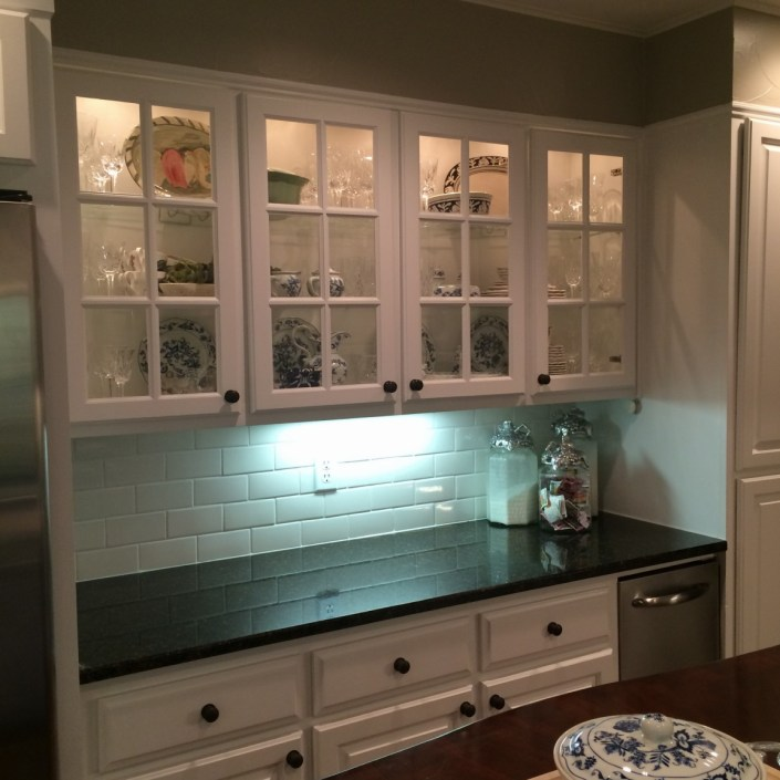 Simple white subway tile kitchen design