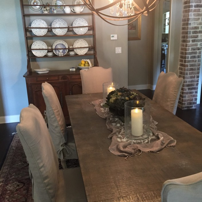 Transitional dining room table and china cabinet