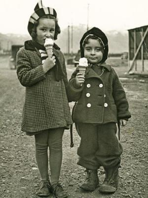 Two children eating ice cream in a historic photo from the Museum collection