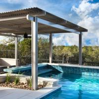 Add a louvered patio cover to your pool to protect your family from UV radiation and blistering sun. Open when not in use to warm swimming pool water. Call Palmetto Outdoor Spaces for a free estimate.