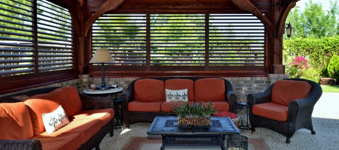 Palmetto Outdoor Spaces sells and installs aluminum shutters for creating an outdoor living space.