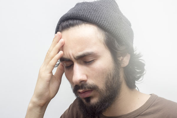 man having overdose with symptom of dizziness