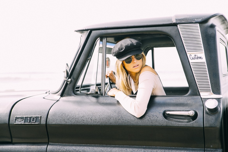 Free People Romper | Rag & Bone Newbury Bootie | Brixton Driving Cap | Rayban Round Sunglasses