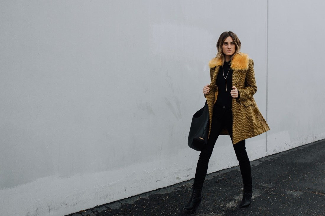 Yellow statement coat on Jennifer Hawkins
