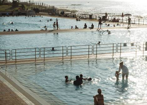 visitors of tropical resort swimming in sea pool