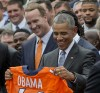 Barack Obama holds up a Denver Broncos jersey as he welcomes the Super Bowl Champions during a ceremony in the Rose Garden yesterday. Standing behind the president is Peyton Manning. (AP Photo/Pablo Martinez Monsivais)</p>
