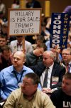 Delegates hold signs during the Libertarian Party National Convention in Orlando. (Reuters/Kevin Kolczynski)</p>