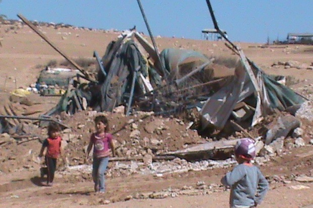 Palestinian children n front of their destroyed home in Zenuta, August 28 2012 (Operation Dove)