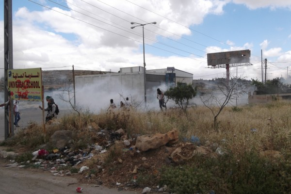 Protesters running away from tear gas (Photo by ISM)