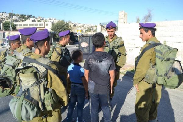Soldiers surround children after their four hour detention