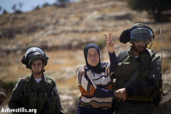 Palestinian activist Neriman Tamimi today being arrested (Photo by: Oren Ziv/Activestills)