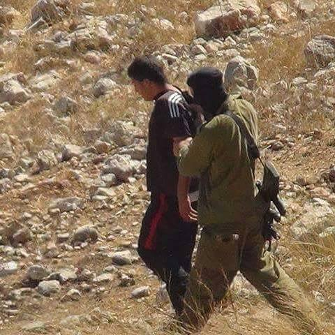 Israeli soldier arresting Mahmoud