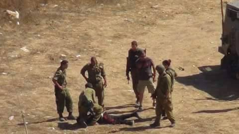 Israeli soldiers arresting Mahmoud in Nabi Saleh