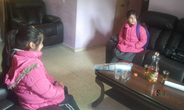 8 year old Hala, on the right side, and 9 year old Hadeel on the left, are the two youngest living in this home.
