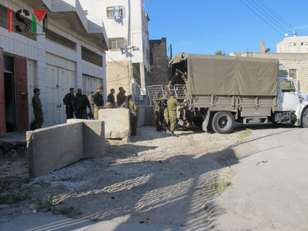 Israeli forces moving into the building next to the girls school