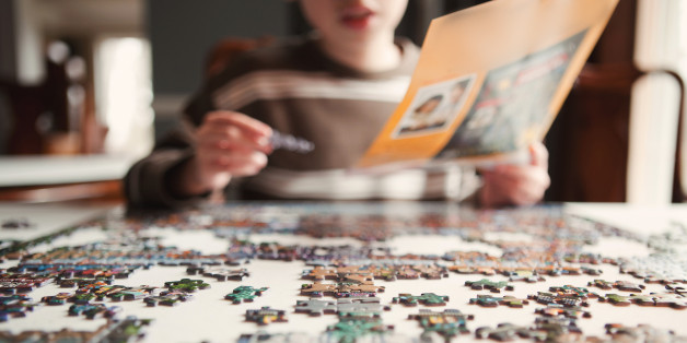 Young boy works on a puzzle.