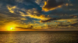 backlit-beach-clouds-700954