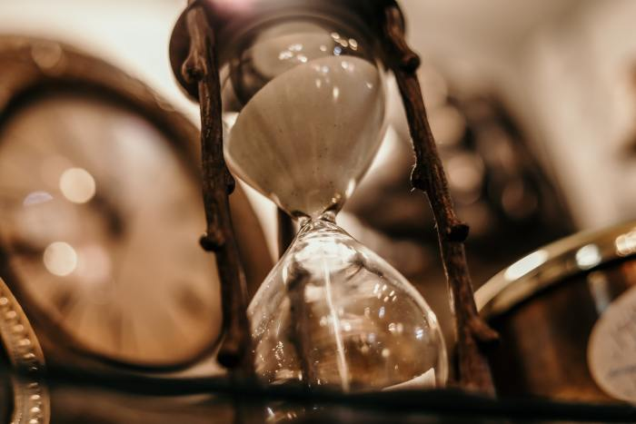 shallow-focus-photography-of-hourglass-1095602
