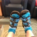 The airport was cold, y'all. You'd have worn 'em too.