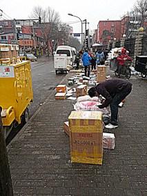 Door to door? Students' online orders are being deliver to one of the main gates of Minzu University