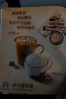 Global but Local. Advertisement for Starbucks: Chesnut Macchiato and Peach Blossom Tea Latte.