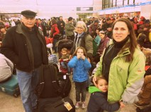 The Novak family waiting for the train