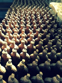 From a tourist store a collection of terracota soldiers ready to go to someone's home