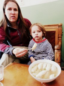 Momos in soup - Dylan loved them, despite the serious face