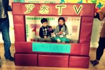 T.V. station with news commentator, Barbie